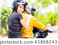 Young woman enjoying riding on motorbike with her boyfriend 43868243