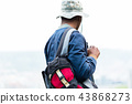 Close-up of boy carrying backpack 43868273