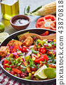 Tasty warm mexican salad with fried tofu, vertical 43870818
