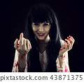 Halloween horror. Crazy bloody scary zombie woman 43871375