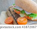 sandwiches with ham, tomatoes, cheese burger 43872067