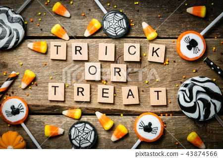 Halloween background - candies and lollipops, straws, wood background 43874566