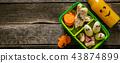 Halloween style school lunch box - ghost sandwich, pumpkin carrots, bananas, juice 43874899