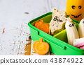 Halloween style school lunch box - ghost sandwich, pumpkin carrots, bananas, juice 43874922