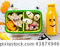 Halloween style school lunch box - ghost sandwich, pumpkin carrots, bananas, juice 43874946