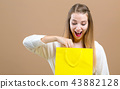 Woman with a shopping bags 43882128