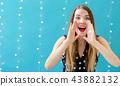 Young woman shouting 43882132