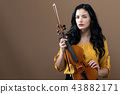 Young woman with a violin 43882171