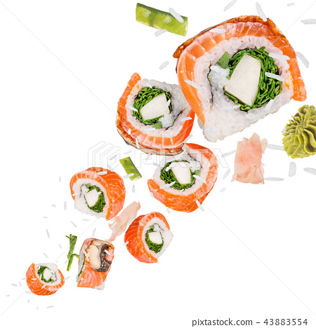 Pieces of delicious japanese sushi frozen in the air. 43883554