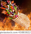 Turkish Kebab yufka with flying ingredients and flames. 43883822