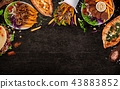 Top down view on traditional turkish meals on black stone table. 43883852