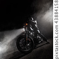 High power motorcycle chopper at night. 43884158