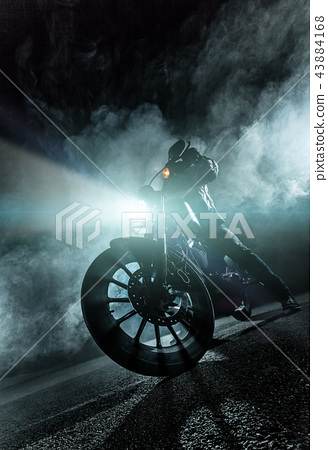 High power motorcycle chopper at night. 43884168