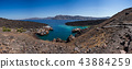 Famous volcano Nea Kameni, view of the cove. Santorini, Greece. 43884259