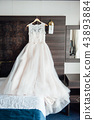 Wedding dress and accessories for the morning of the bride 43893884