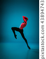 The male athletic ballet dancer performing dance on blue background. Studio shot. Ballet concept 43894743
