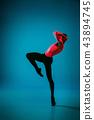 The male athletic ballet dancer performing dance on blue background. Studio shot. Ballet concept 43894745