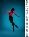 The male athletic ballet dancer performing dance on blue background. Studio shot. Ballet concept 43894760