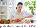 woman is cooking vegetables 43901458