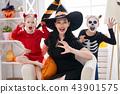 family celebrating Halloween 43901575