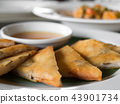 close up of crispy spring roll stuffed with prawns 43901734
