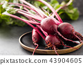Beet, beetroot bunch on wooden plate on grey stone background. Copy space. . 43904605