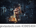 Shamans boy at the fire 43905404