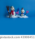 Two snowmen characters on blue background. Xmas New Year comical greeting card with funny snowman 43906451