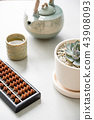 japanese style of bamboo abacus and hot tea  43908093