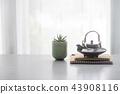 Japanese ceramic tea pot and tea cup  on table 43908116