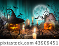 Halloween pumpkins on wooden planks. 43909451