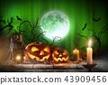 Halloween pumpkins on wooden planks. 43909456