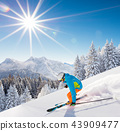 Skier skiing downhill in high mountains 43909477