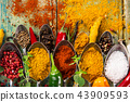 Various colorful spices on wooden table 43909593