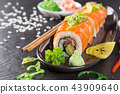 Japanese sushi set on a rustic dark background. 43909640