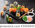 Japanese sushi set on a rustic dark background. 43909644