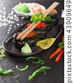 Japanese sushi set on a rustic dark background. 43909649