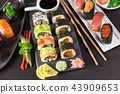 Japanese sushi set on a rustic dark background. 43909653