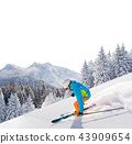 Skier skiing downhill in high mountains 43909654