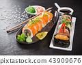 Japanese sushi set on a rustic dark background. 43909676