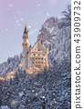 Neuschwanstein Castle during sunrise in winter landscape. 43909732