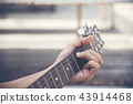 Man hand playing guitar 43914468