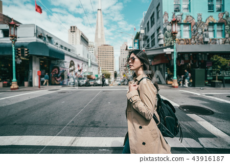 female walking across the road with stylish look 43916187