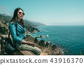 woman looking tired and sitting on the bench 43916370