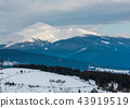 Evening winter cloudy day mountain ridge 43919519