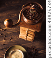 Old wooden coffee grinder with beans 43925734