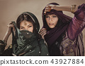 Arabian woman traveling in desert. 43927884