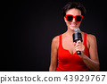 Mature beautiful woman with short hair against black background 43929767