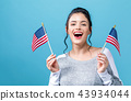 Young woman with American flag 43934044
