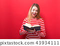 Young woman with a book 43934111